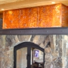 Flamed and Pounded Fireplace Surround with Forged Steel Mantle and Doors