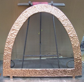 Pounded Mirrored Copper Surround with Steel Mesh